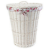 White wicker laundry basket with floral lining