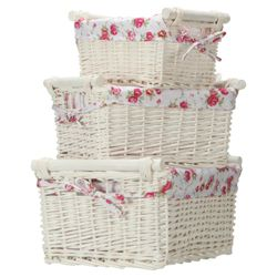 White wicker set of 3 baskets with wooden handles and floral lining