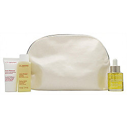 Clarins Skincare Gift Set 30ml Blue Orchid Face Treatment Oil + 15ml Gentle Refiner Exfoliating Cream + 50ml Toning Lotion + Bag