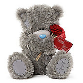 Me to You Tatty teddy bear holding flowers with love tag