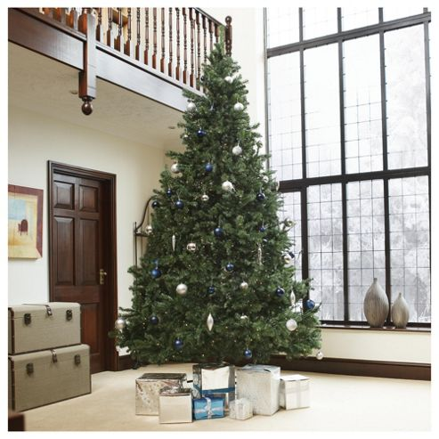 Festive 12ft Pre-lit Colorado Spruce Christmas Tree with warm white LED lights