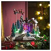 Rotating Santa and Sleigh House Christmas Decoration