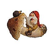 Sitting Gnome Holding Apple On Rustic Mushroom Ornament