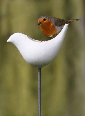 Porcelain bird feeder with a pole