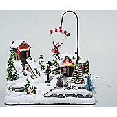 Light Up LED Christmas Village With Moving Parachute - 30x19x31cm