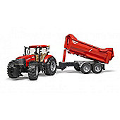 Case IH Puma CVX 230 with Krampe Halfpipe Trailer