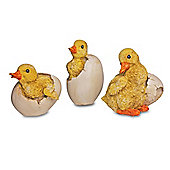 A Set Of Three Hatching Duckling Garden Ornaments In Coloured Resin