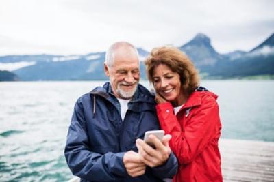 Older couple taking selfie